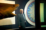 British artist Damien Hirst's business manager Frank Dunphy pictured with some of Hirst's artworks which were sold in a two day auction at Sotheby's in London in September 2008, earning Hirst a reported £95 million.