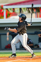 Corey Farris #45 of the Bristol White Sox follows through on his swing against the Burlington Royals at Burlington Athletic Park on July 9, 2011 in Burlington, North Carolina.  The Royals defeated the White Sox 3-2.   (Brian Westerholt / Four Seam Images)
