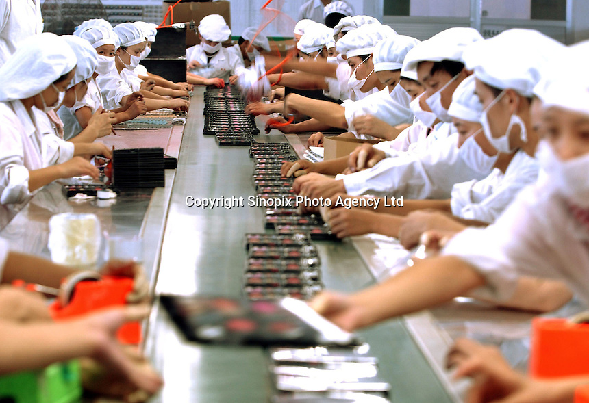 Workers on a production line that produces lipstick, mascara and other cosmetics at a factory in the Pear River Delta in Fu Yong, near the Shenzhen special Economic Zone in China.