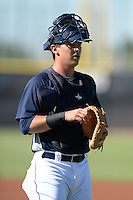 Seattle Mariners catcher Juan Camacho (58) during practice before an Instructional League game against the Milwaukee Brewers on October 4, 2014 at Peoria Stadium Training Complex in Peoria, Arizona.  (Mike Janes/Four Seam Images)