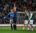 Fraser Fyvie holds his head as ref Bobby Madden red cards Andy Halliday