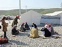 Iraq 2015 <br /> In the camp of Berseve, Yaazidi men discussing near the tents where they lived  <br /> Irak 2015 <br /> Au camp de Berseve , homes Yezidi discutant a coté des tentes ou ils vivent.