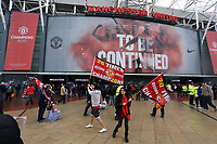 "Pictured: A young man and woman holding a ""20 Times Champions"" flag outside the ground before kick off. Sunday 12 May 2013<br />