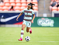 HOUSTON, TX - JUNE 13: Catarina Amado #2 of Portugal dribbles the ball during a game between Nigeria and Portugal at BBVA Stadium on June 13, 2021 in Houston, Texas.