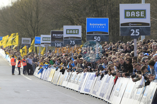 Massive crowds wait at the finish line in Oudenaarde at the end of the 96th edition of The Tour of Flanders 2012, running 256.9km from Bruges to Oudenaarde, Belgium. 1st April 2012. <br /> (Photo by Eoin Clarke/NEWSFILE).