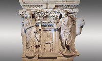 Roman sarcophagus with relief sculptures from Hierapolis . Hierapolis Archaeology Museum, Turkey<br /> <br /> Columned Sarcophagus Sarcopinagu of Euthios Pyrrnon, Asian Archon (ruler), Roman Period First quarter of third century A.D. Loadicea. <br />  <br /> Four sides of these sarcophagi are all in relief. They appear like a columned temple. The reliefs between the grooved columns are related to the private life of the individual. His/her education, heroic scenes and plant or mythological motifs are decorated in relief. The cover of the sarcophagus is arranged like a bed and it is depicted as the wife and the husband as lying on it. The name of the individual and some mythological reliefs are found in the surrounding of the cover. The two sarcophagi in the hall are of this kind. . Against a grey background