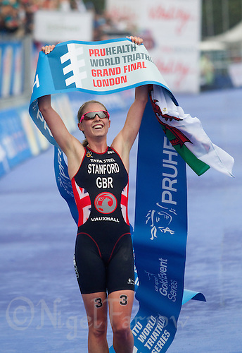 14 SEP 2013 - LONDON, GBR - Non Stanford (GBR) of Great Britain celebrates winning the women's ITU 2013 World Triathlon Series Grand Final in Hyde Park, London, Great Britain (PHOTO COPYRIGHT © 2013 NIGEL FARROW, ALL RIGHTS RESERVED)