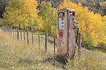 Antique gasoline pump rusting in the San Juan Mountains, near Telluride, Colorado.