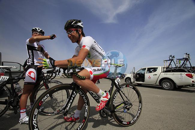 GreenEdge Cycling Team rider Japanese Champion Beppu Fumiyuki (JPN) chats to fellow countryman Kazuo Inoue of the Bridgestone Anchor team before the start of Stage 4 of the 2012 Tour of Qatar from Al Thakhira to Madinat Al Shamal, Qatar. 8th February 2012.<br /> (Photo Eoin Clarke/Newsfile)