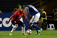 BOGOTA - COLOMBIA – 17 - 04 - 2018: Jair Palacios (Der.) jugador de Millonarios (COL), disputa el balon con Daniel Carrillo (Izq.) jugador de Deportivo Lara (VEN), durante partido entre Millonarios (COL) y Deportivo Lara (VEN), de la fase de grupos, grupo G, fecha 3 de la Copa Conmebol Libertadores 2018, en el estadio Nemesio Camacho El Campin, de la ciudad de Bogota. / Jair Palacios (R) player of Millonarios (COL), figths for the ball with Daniel Carrillo (L) player of Deportivo Lara (VEN), during a match between Millonarios (COL) and Deportivo Lara (VEN), of the group stage, group G, 3rd date for the Conmebol Copa Libertadores 2018 in the Nemesio Camacho El Campin stadium in Bogota city. VizzorImage / Luis Ramirez / Staff.