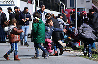Pictured: Young children play on the motorway Thursday 25 February 2016<br />Re: Hundreds of migrants, including families with young children, that were stranded at Tempe in central Greece, were forced to walk on foot on the motorway to reach Idomen, about 168 kilometres away, in the northern part of the country, at the Greek FYRO Macedonian border. Local police were at first escorting them, then made sure that they were safely transported on coaches.