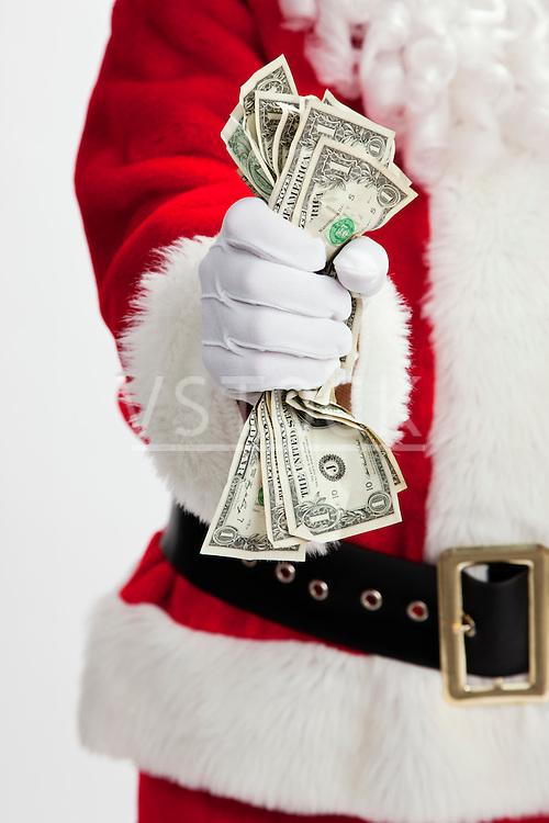 USA, Illinois, Metamora, Midsection of Santa Claus holding cash