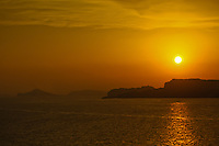A beautiful sunset over the water and land in the Mediterranean