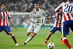 Real Madrid's Cristiano Ronaldo (C) and Atletico del Madrid´s Gabi and Tiago Cardoso during quarterfinal second leg Champions League soccer match at Santiago Bernabeu stadium in Madrid, Spain. April 22, 2015. (ALTERPHOTOS/Victor Blanco)