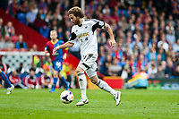 Sun 22 September 2013<br /> <br /> Pictured: Jose Canas  of Swansea takes the ball forward<br /> <br /> Re: Barclays Premier League Crystal Palace FC  v Swansea City FC  at Selhurst Park, London