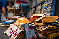 Used books are seen lying disorganized on the street in a secondhand bookshop in San Salvador, El Salvador, 12 April 2018. Large collections of worn-out books, mostly textbooks and educational paperbacks, are sold regularly in secondhand bookshops in the center of the city.