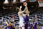 SIOUX FALLS, SD - MARCH 6: Brady Heiman #45 of the South Dakota Coyotes tries to shoot over Will Carius #25 of the Western Illinois Leathernecks during the Summit League Basketball Tournament at the Sanford Pentagon in Sioux Falls, SD. (Photo by Richard Carlson/Inertia)