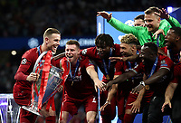 Liverpopol's captain Jordan Henderson, left, preparers to hold up the trophy at the end of the UEFA Champions League final football match between Tottenham Hotspur and Liverpool at Madrid's Wanda Metropolitano Stadium, Spain, June 1, 2019. Liverpool won 2-0.<br /> UPDATE IMAGES PRESS/Isabella Bonotto