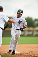 GCL Yankees East catcher Pedro Diaz (53) is congratulated as he rounds third base after hitting a home run in the bottom of the second inning during the first game of a doubleheader against the GCL Yankees West on July 19, 2017 at the Yankees Minor League Complex in Tampa, Florida.  GCL Yankees West defeated the GCL Yankees East 11-2.  (Mike Janes/Four Seam Images)