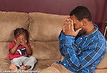 17 month old toddler boy playing peek a boo with his father
