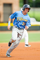Drew Robinson (33) of the Myrtle Beach Pelicans hustles towards third base against the Winston-Salem Dash at BB&T Ballpark on July 7, 2013 in Winston-Salem, North Carolina.  The Pelicans defeated the Dash 6-5 in 8 innings in game two of a double-header.  (Brian Westerholt/Four Seam Images)