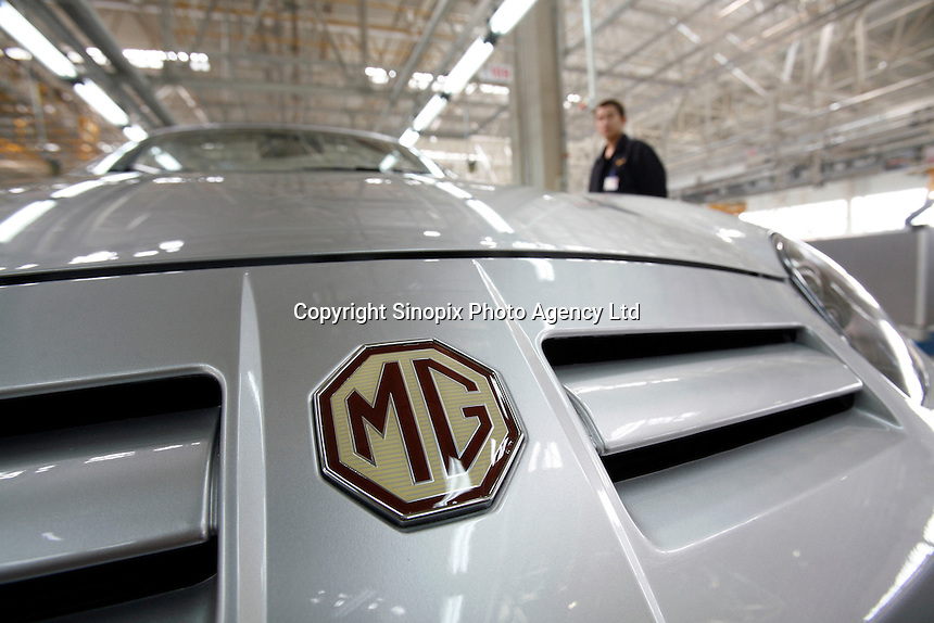 A Chinese worker stands near a MG car at the Nanjing MG Automibile Corporation plant before the vehicle's launch in Nanjing, China. The Chinese company is now in a position to take on Rover's assets and plan its future. It intended to relocate the engine plant and some car production plant to China but to retain some car production plant in the UK..27 Mar 2007
