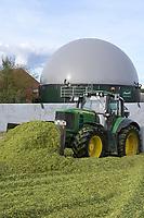 Germany, Biogas plant / DEUTSCHLAND, Damnatz im Wendland, Hof und Biogasanlage von Horst Seide, John Deere Traktor mit Dieselantrieb beim Maissubstrat schieben