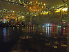 Christmas lights and other reflections in the window of The Royal Tavern, Greenwich, London, looking across the Thames to the O2.<br /> <br /> Stock Photo by Paddy Bergin
