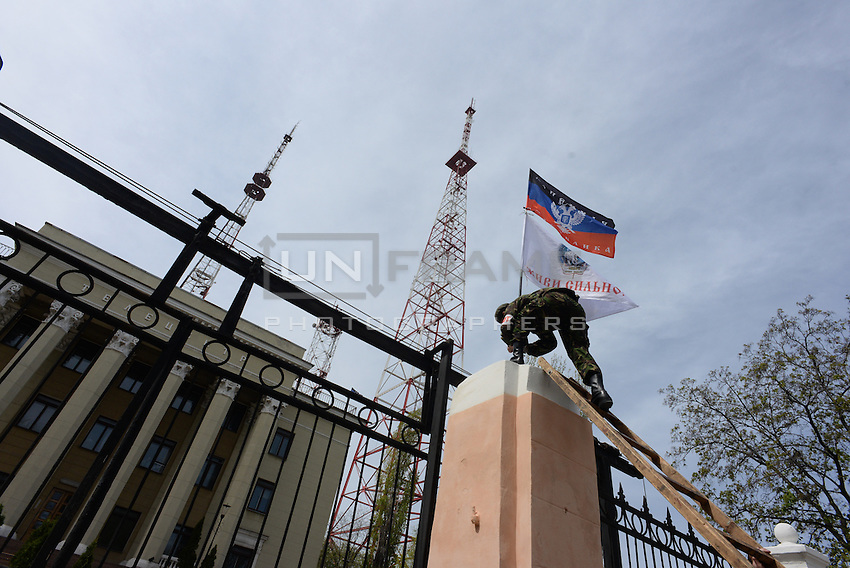 Pro-russian activists take control over the local Ukrainian television in Donetsk city.  Ukraine