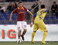 Calcio, Serie A: Roma vs Chievo Verona, Stadio Olimpico, Roma, 7 maggio  2013..AS Roma forward Francesco Totti, left, is challenged by ChievoVerona defender Paul Papp, of Romania, during the Italian serie A football match between Roma and ChievoVerona at Rome's Olympic stadium, 7 maggio  2013..UPDATE IMAGES PRESS/Isabella Bonotto