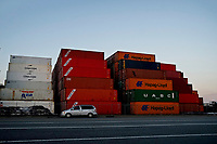 ELIZABETH, NEW JERSEY - MARCH 03: A car wait next to containers at Port Elizabeth on March 03, 2021 in Elizabeth, New Jersey. According projections the EE.UU economy rises 5,5% in 2021. where the excess savings in North American households will return to the market after vaccination and boosting consumption. (Photo by VIEWpress)