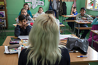 Serbia. Zitkovac is a village in Central Serbia situated in the municipality of Aleksinac, in the Nišava District. «Vuk Karadzic» Elementary School. Classroom. 5th Grade. A blond teacher during a Serbian class.The school's students are from Serbian and Romani ethnicity. The boys with black hair and dark skin complexion (seated on the fist row (L) and second row (R), and the girl seated on the second row (L), all three are Roma children. The others are Serbian. The Romani (also spelled Romany) or Roma, Roms or Gypsies, are a traditionally itinerant ethnic group. The Pestalozzi Children's Foundation (Stiftung Kinderdorf Pestalozzi) is advocating access to high quality education for underprivileged children. It supports in Zitkovac a project called» Together in transition».19.4.2018 © 2018 Didier Ruef for the Pestalozzi Children's Foundation