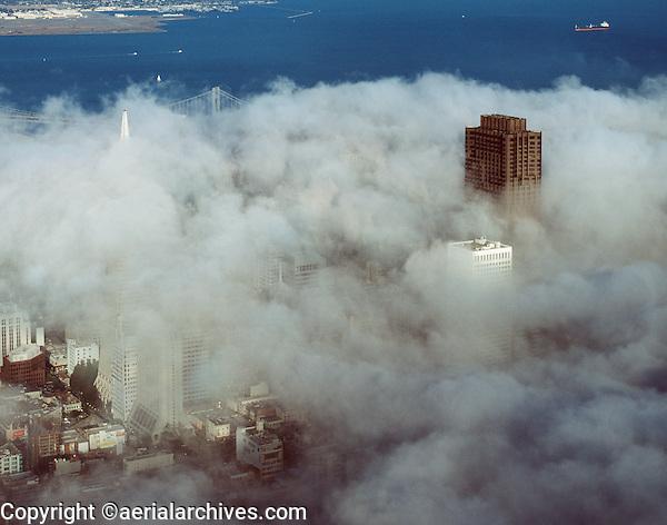 aerial photograph of 555 California Street, former Bank of America Center, Transamerica Pyramid, San Francisco, California in the fog