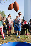 September 15, 2017- Tuscola, IL- Northward 2nd graders toss footballs toward the round bucket during the 1st annual Tiger Trot. [Photo: Douglas Cottle]