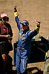 Driver Ken Block celebrates after crossing the finish line while competing in the Rally Car Race finals during X-Games 12 in Los Angeles, California on August 5, 2006.