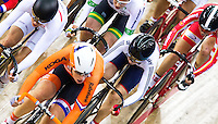 06 DEC 2014 - STRATFORD, LONDON, GBR - Laura Trott (GBR) (bottom right) from Great Britain races in the pack during the women's Omnium 10km Scratch Race at the 2014 UCI Track Cycling World Cup at the Lee Valley Velo Park in Stratford, London, Great Britain (PHOTO COPYRIGHT © 2014 NIGEL FARROW, ALL RIGHTS RESERVED)