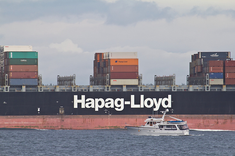 Yacht passing Container Ship, Savannah Express, Hapag-Lloyd line, in bound Seattle, Puget Sound, Washington State, Pacific Northwest, USA,