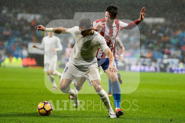 Real Madrid's player Pepe and Sporting de Gijon's player Carmona during match of La Liga between Real Madrid and Sporting de Gijon at Santiago Bernabeu Stadium in Madrid, Spain. November 26, 2016. (ALTERPHOTOS/BorjaB.Hojas)