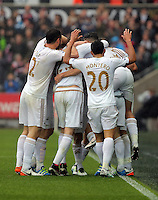 Jack Cork of Swansea City celebrates his goal with team mates during the Barclays Premier League match between Swansea City and Liverpool at the Liberty Stadium, Swansea on Sunday May 1st 2016