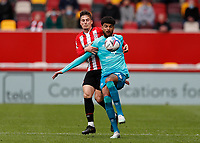 22nd May 2021; Brentford Community Stadium, London, England; English Football League Championship Football, Playoff, Brentford FC versus Bournemouth; Philip Billing of Bournemouth is challenged by Sergi Canos of Brentford