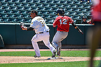 Alex Sanabia (34) of the Salt Lake Bees just beats Ramiro Pena (12) of the El Paso Chihuahuas to the bag at Smith's Ballpark on July 26, 2015 in Salt Lake City, Utah. El Paso defeated Salt Lake 6-3 in 10 innings. (Stephen Smith/Four Seam Images)