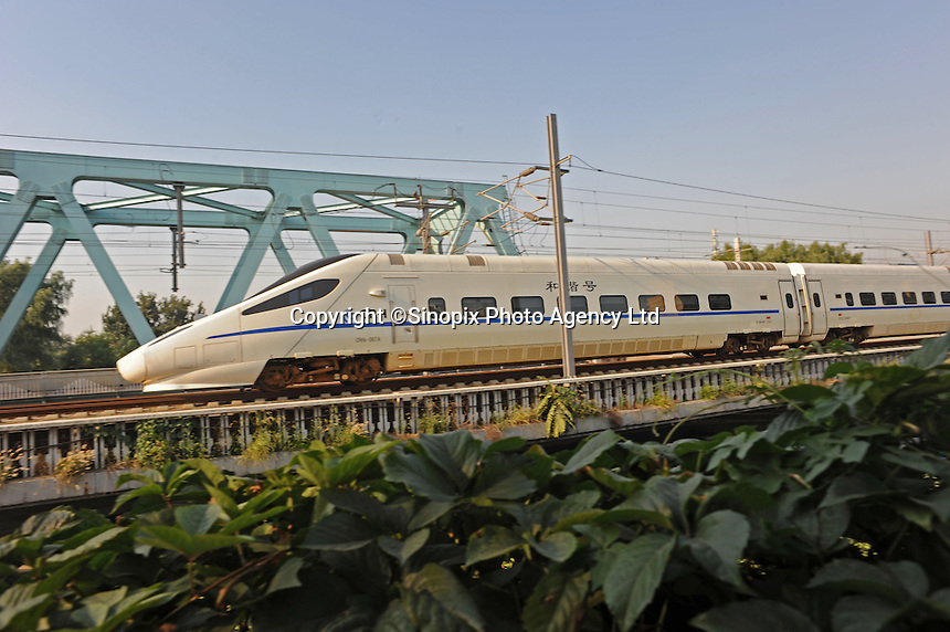 "A high-speed rail of China Railway High(CRH) passing by area in Beijing, China. CRH is similar to French TGV or Japanese ""bullet trains"", but far larger and faster. Many lines are already in service. The speeds of CRH attained vary considerably from line to line. Some routes such as the current(July 2010) Beijing-Shanghai link, run on ordinary-looking rail lines and have a top speed of 200-250 km/hr. Newer lines are faster, up to 350 km/hr, these include the Beijing-Tianjin line, Guangzhou-Wuhan line, Zhengzhou-Xian line, and a new Shanghai-Nanjiang line..29 Aug 2010"