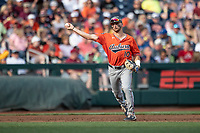 Auburn Tigers third baseman Edouard Julien (10) makes a throw to first base during Game 4 of the NCAA College World Series against the Mississippi State Bulldogs on June 16, 2019 at TD Ameritrade Park in Omaha, Nebraska. Mississippi State defeated Auburn 5-4. (Andrew Woolley/Four Seam Images)