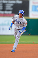 Daytona Cubs shortstop Javier Baez #12 runs the bases after hitting a home run to center during a game against the Brevard County Manatees at Spacecoast Stadium on April 5, 2013 in Melbourne, Florida.  Daytona defeated Brevard County 8-0.  (Mike Janes/Four Seam Images)