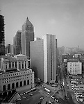 Pittsburgh PA: View down Liberty Ave toward the William Moorhead Federal Building.  The photograph was taken from the top of the PA Railroad Station.<br /> US Post Office and Courts on left and Gulf and Koppers Building in the background, And the US Steel Building under construction on the left side of the image.