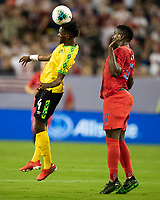 NASHVILLE, TN - JULY 3: Andre Lewis #4 heads the ball in front of Jozy Altidore #17 during a game between Jamaica and USMNT at Nissan Stadium on July 3, 2019 in Nashville, Tennessee.