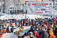 Wade Marrs giving a high-five to a fan on Willow Lake at the Official Start of the 2018 Iditarod Sled Dog Race in Willow, Alaska on March 04, 2018. <br /> <br /> Photo by Jeff Schultz/SchultzPhoto.com  (C) 2018  ALL RIGHTS RESERVED