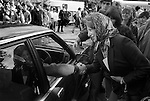 Prince Charles playing Polo at the Ham Polo Club Surrey, UK 1980s. 1981 Driving his car, leaving the club,shaking hands with well wisher, woman in headscarf.