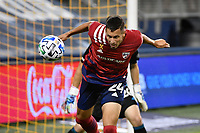 KANSAS CITY, KS - SEPTEMBER 02: Matt Hedges #24 of FC Dallas heads the ball during a game between FC Dallas and Sporting Kansas City at Children's Mercy Park on September 02, 2020 in Kansas City, Kansas.