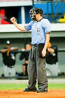 Home plate umpire Alex Ziegler signals an out during the Appalachian League game between the Bristol White Sox and the Burlington Royals at Burlington Athletic Park on July 10, 2011 in Burlington, North Carolina.  The White Sox defeated the Royals 4-3.   (Brian Westerholt / Four Seam Images)